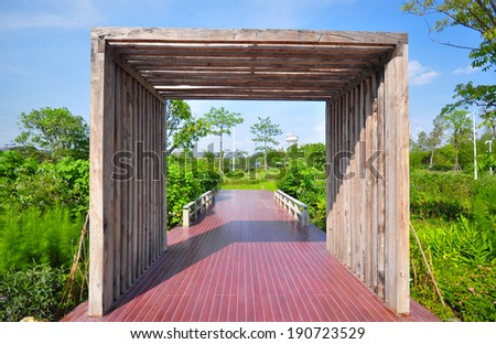 Luxury wood gate to the entrance in the garden - stock photo