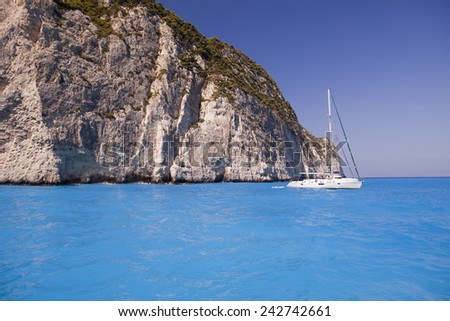 Luxury yacht anchored on Navagio beach (also known as shipwreck beach), Zakynthos island, Greece - stock photo