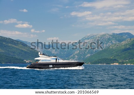 Luxury yacht cruising in the bay