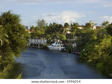 Luxury Yacht in a Coral Gables, Florida canal - stock photo