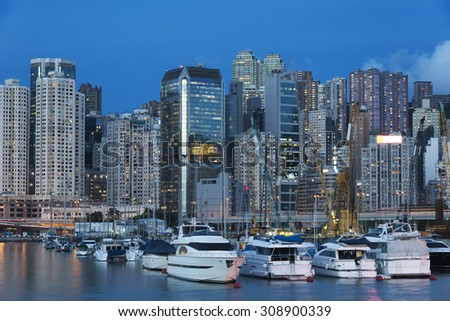 Luxury yacht in port in Hong Kong Harbor at dusk