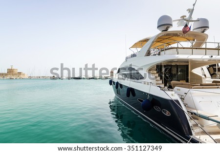 Luxury yacht in Rhodes harbor - stock photo