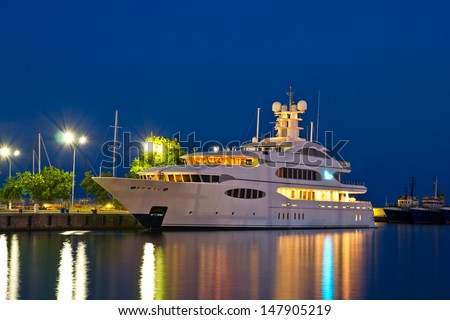Luxury yacht in the port at night - stock photo
