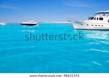 Luxury yacht in turquoise beach of Formentera Illetes - stock photo