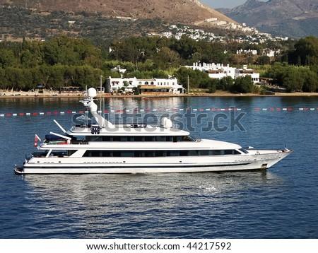 Luxury yacht leaving from Bodrum resort - stock photo