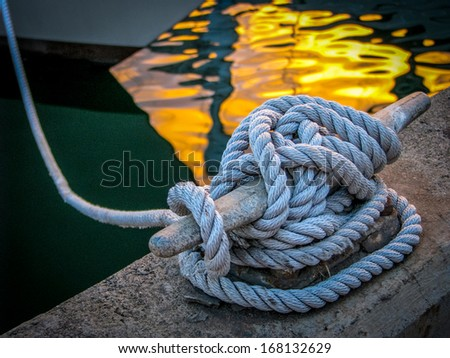 Luxury Yacht Moored At Sunset - stock photo