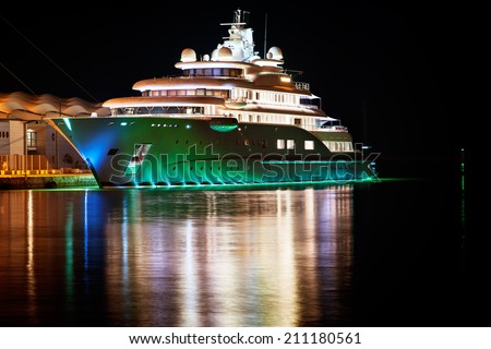 Luxury yacht moored in the harbor next to the cruise terminal - stock photo