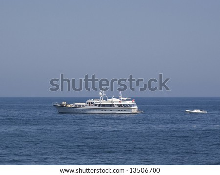 luxury yacht pulling a lifeboat - saint-tropez, french riviera