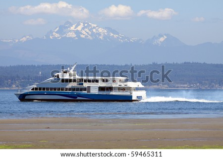 Luxury yacht with Cascade Mountain Range in background