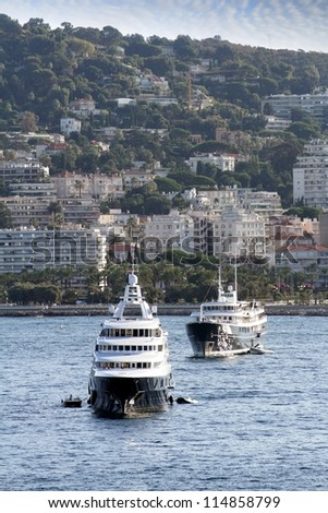 Luxury yachts anchored close to Cannes port, France. - stock photo