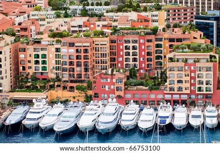 Luxury yachts and elite apartments in the port of Monaco - stock photo