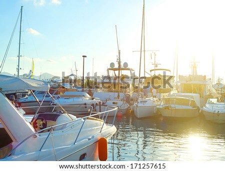 Luxury yachts docked in Cannes harbor - stock photo