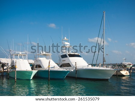 Luxury yachts moored in the marina of the Caribbean sea - stock photo