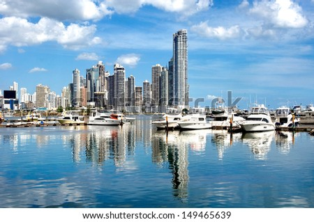 Luxury yachts on the background of skyscrapers with water reflection - Panama City - stock photo