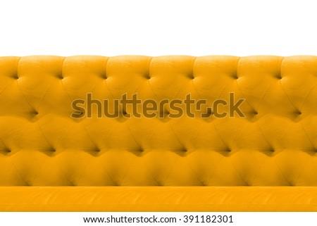 Luxury Yellow or Gold sofa velvet cushion close-up pattern background on white - stock photo