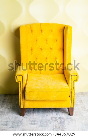 Luxury yellow sofa in the background of the  room