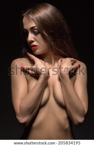 luxury young woman covering her breasts