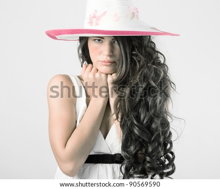 Luxury young woman in a white summer hat. - stock photo