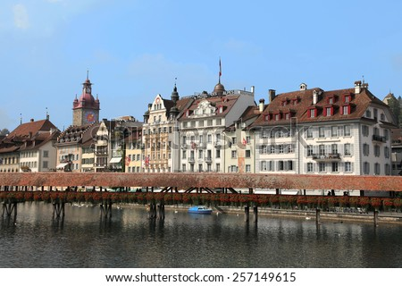 LUZERN, SWITZERLAND - SEPTEMBER 8, 2009: Luzern cityscape on September 8, 2009 in Luzern, Switzerland. Lake Luzern and the historic city centre is a Swiss heritage of national significance. - stock photo