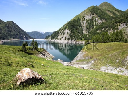 Luzzone lake dike - stock photo