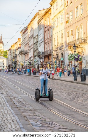 Lviv - June 08: A young girl on a Segway, Cheven 08, 2015, Lviv, Ukraine