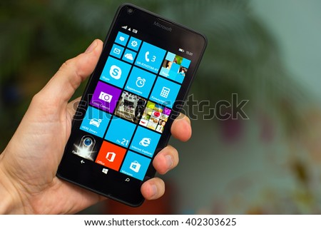 LVIV, UKRAINE - apr 06, 2016:  Microsoft Lumia 640 Windows Phone with icon on screen in hand - stock photo