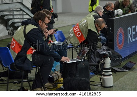 LVIV, UKRAINE - APR 28: Photographers work with laptop during the semi finals UEFA Europa League match between Shakhtar vs FC Sevilla (Spain), 28 April 2016, Arena Lviv, Ukraine