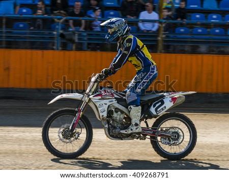 Lviv, Ukraine - 17 April 2016: Unknown rider preparing to start at the  Flat Track  National Championship  to the Lviv city - stock photo