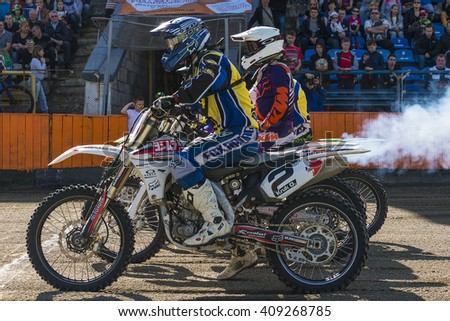 Lviv, Ukraine - 17 April 2016: Unknown riders preparing to start at the  Flat Track  National Championship  to the Lviv city - stock photo