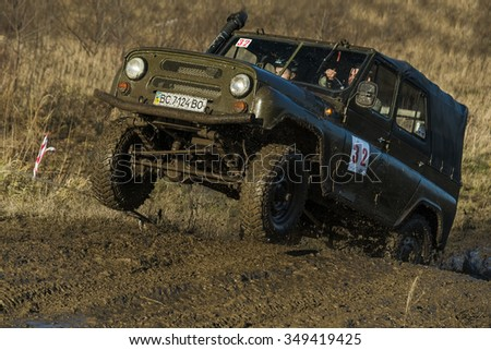 Lviv,Ukraine- December 6, 2015: Unknown rider on the off-road vehicle brand UAZ overcomes a route off road at Zub - Trial 2015 near the city of Lviv, Ukraine