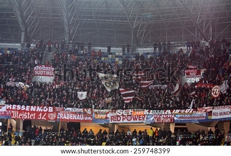 LVIV, UKRAINE - FEBRUARY 17, 2015: FC Bayern Munich team supporters show their support during UEFA Champions League game against Shakhtar Donetsk at Arena Lviv - stock photo