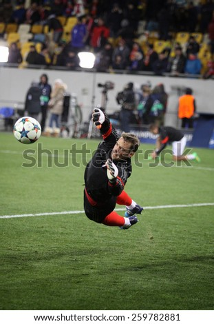 LVIV, UKRAINE - FEBRUARY 17, 2015: Goalkeeper Manuel Neuer of Bayern Munich in action during warm up session before UEFA Champions League game against FC Shakhtar Donetsk - stock photo