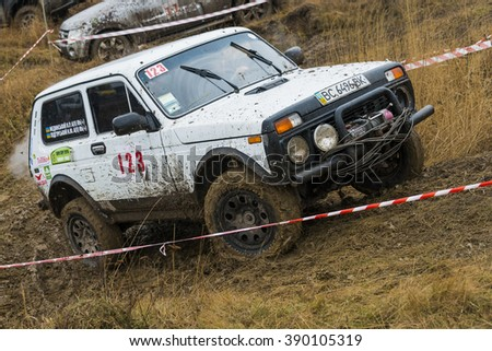 Lviv, Ukraine - February 21, 2016: Off-road vehicle brand VAZ - NIVA (No. 123) overcomes the track on a amateur competitions Trial near the city Lviv, Ukraine