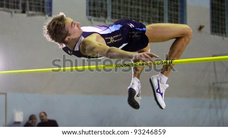 LVIV,UKRAINE-JAN.20: Krymarenko Yuriy the World Champion in Helsinki 2005, compete in high jump with result 2.24 on the Memorial Demyanyuk track and field meeting, on January 20, 2012 in Lviv, Ukraine - stock photo