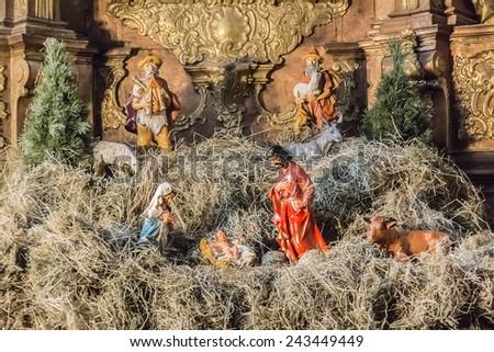 LVIV, UKRAINE - JANUARY 7, 2015: Interior of Sts. Peter and Paul Garrison Church (former Jesuits Church, 1610 - 1630, architect Giacomo Briano). Symbol of Christmas - Nativity scene. - stock photo