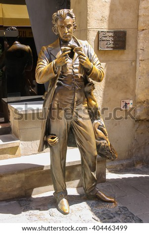 Lviv, Ukraine - July 5, 2014: Statue of Leopold von Sacher Masoch near entrance of Masoch-cafe  in historic city centre