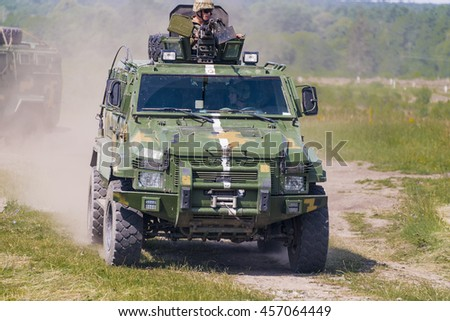 Lviv, Ukraine - July 6, 2016: Ukrainian-American joint military exercises near the Lviv rapid trident 2016. Ukrainian military vehicle KrAZ Spartan with comandos attack simulated enemy Lviv.Ukraine.