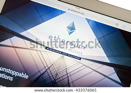 LVIV, UKRAINE - Jun 06, 2016: tablet pc with etherium main page site on screen, etherium is a second coin in crypto-currency market capitalizations in world - stock photo