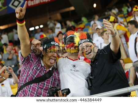 LVIV, UKRAINE - JUNE 17, 2012: Germany football team supporters show their support during UEFA EURO 2012 game against Denmark at Lviv Arena in Lviv, Ukraine. Germany won 2-1 - stock photo