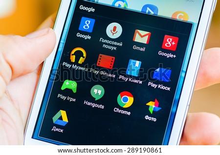 LVIV, UKRAINE - May 19, 2015: Hand holding white Samsung Smart Phone with Google application - stock photo