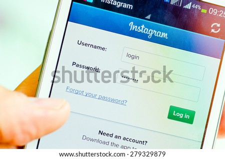 LVIV, UKRAINE - May 19, 2015: Hand holding white Samsung Smart Phone with Instagram social Network Log In Screen - stock photo