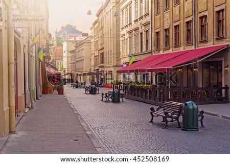 LVIV, UKRAINE - MAY 8, 2016:  Morning in the center of Lviv. Empty old-style streets full of cafes and restaurants, Ukraine