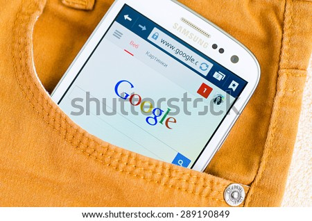 LVIV, UKRAINE - May 19, 2015: white Samsung Smart Phone with Google search site in orange jeans pocket - stock photo