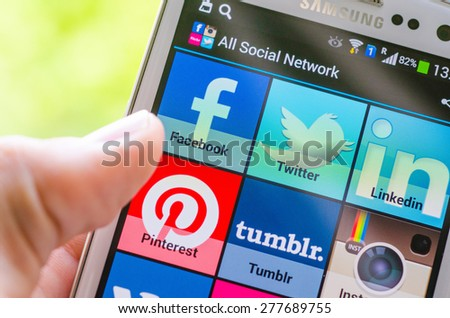 LVIV, UKRAINE - May 03, 2015: White Samsung Smart Phone with   social media applications  on screen (facebook, twitter,linkedln, pinterest, tumblr) - stock photo