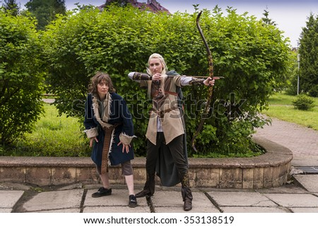 Lviv, Ukraine - May 23,2015: Women, dressed in the style of the Middle Ages performs on stage at the festival cosplay Anicon in Lviv May 23.2015
