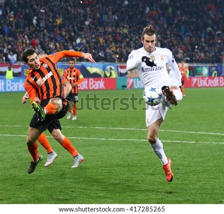 LVIV, UKRAINE - NOVEMBER 25, 2015: Gareth Bale of Real Madrid (R) kicks the ball during UEFA Champions League game against FC Shakhtar Donetsk at Arena Lviv stadium - stock photo