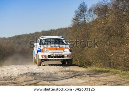 Lviv, Ukraine - November 1, 2015: Racers Oleg Slezinskij and Serhiy Bryckiy on the car brand Opel Kadett (No.29) overcome the track at the annual Rally of Galicia, near the city of Lviv, Ukraine - stock photo