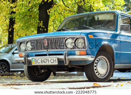 Lviv, Ukraine, Oct 6, 2014: blue VAZ-2103 Zhiguli (Lada) compact sedan car (released circa 1980 in USSR by AvtoVAZ) parked on Bandera street. - stock photo