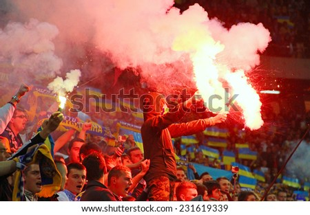 LVIV, UKRAINE - OCTOBER 12, 2014: Ukrainian team supporters burn flares during the UEFA EURO 2016 Qualifying game between Ukraine and Macedonia on Lviv Arena - stock photo