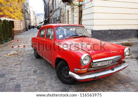 "LVIV, UKRAINE - OCTOBER 10: Vintage car GAZ-M20 ""Pobeda"" on the empty street of the Old Town on October 10, 2012 in Lviv, Ukraine. The car was produced in the Soviet Union by GAZ from 1946 until 1958. - stock photo"